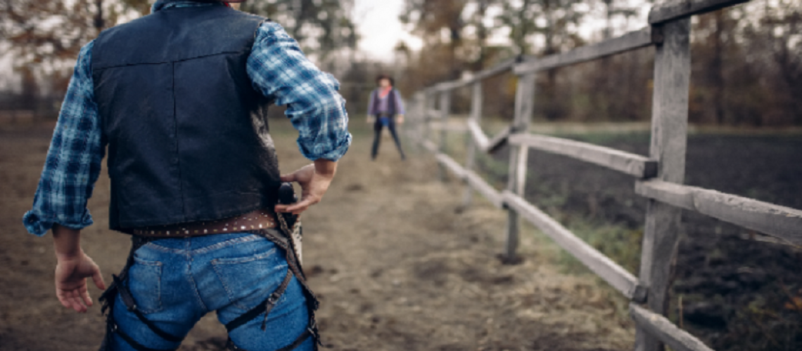 cowboy-with-gun-prepares-to-gunfight-back-view-G9Z5LWN